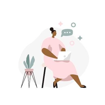 Femme assise avec ordinateur portable pigiste à la maison. travail en ligne, conversation en ligne.