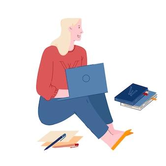 Femme assise sur le sol avec un ordinateur portable dans les mains