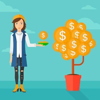 Femme attrapant des pièces d'un dollar.