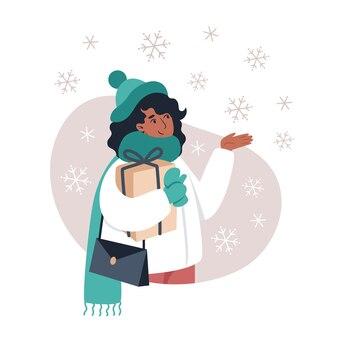 Femme attrape des flocons de neige avec sa main