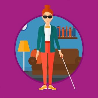 Femme aveugle avec un bâton.