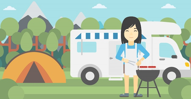 Femme ayant un barbecue devant le camping-car.