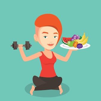 Femme en bonne santé avec des fruits et des haltères.