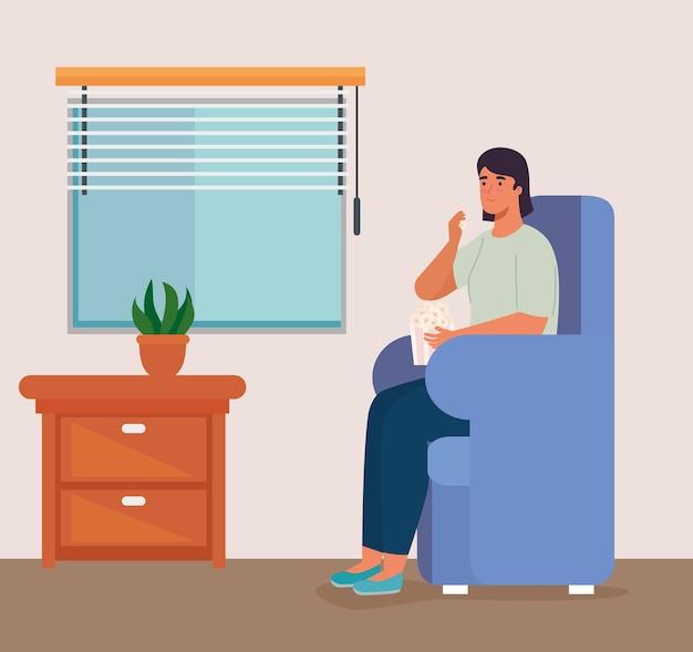 Femme sur chaise avec pop corn à la maison conception d'activités et de loisirs