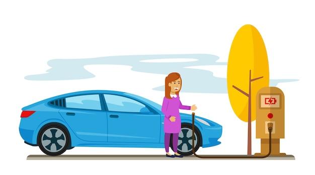 Femme chargeant sa voiture électrique dans le parking