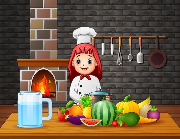Une femme chef prépare la nourriture à la table à manger