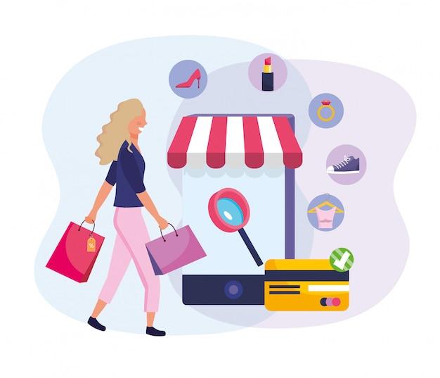 Femme avec commerce électronique sur smartphone et sacs à provisions