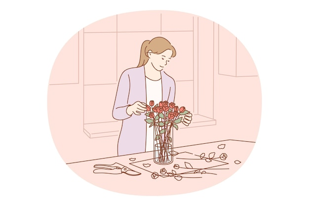 Femme coupant avec des ciseaux et mettant le bouquet de roses fraîches