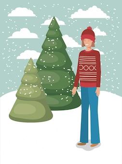 Femme dans le paysage de neige avec des vêtements d'hiver