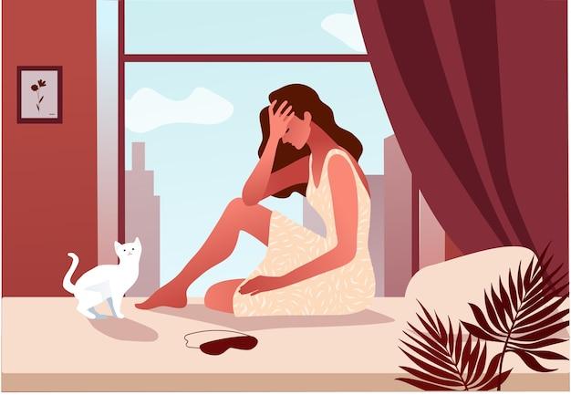 Femme dans sa chambre se réveiller avec un mal de tête