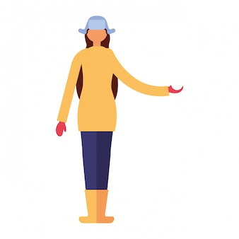 Femme debout avec des vêtements d'hiver