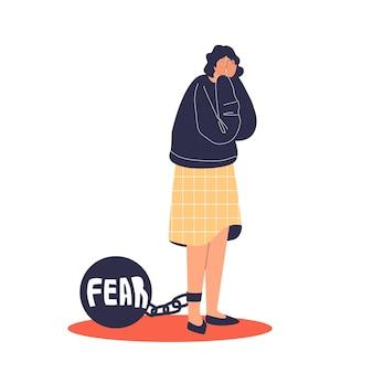 Femme déprimée effrayée avec poids de peur sur la chaîne
