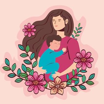 Femme enceinte portant bébé garçon avec décoration fleurs vector illustration design