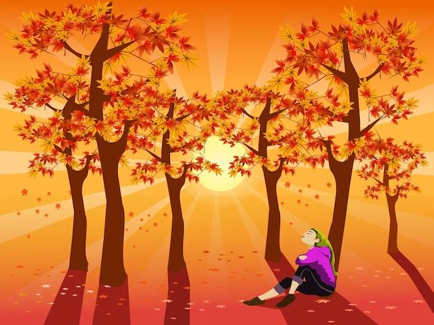 Une femme est assise sous un érable avec le coucher de soleil scintillant en arrière-plan.
