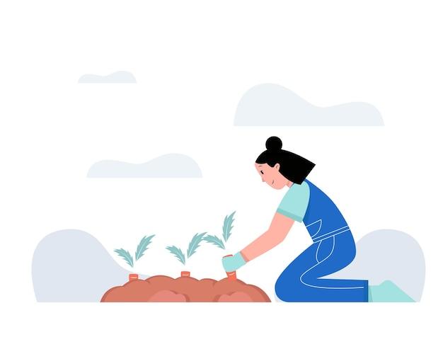 Femme faisant de l'agriculture dans le jardin