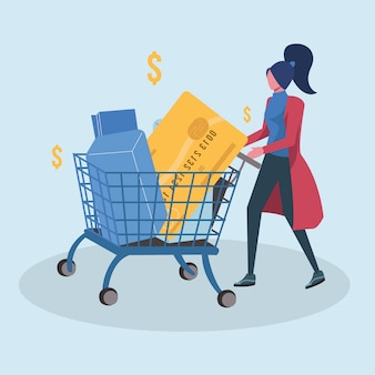 Femme faisant du shopping avec un chariot de carte de crédit