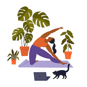 Femme faisant du yoga à la maison avec chat
