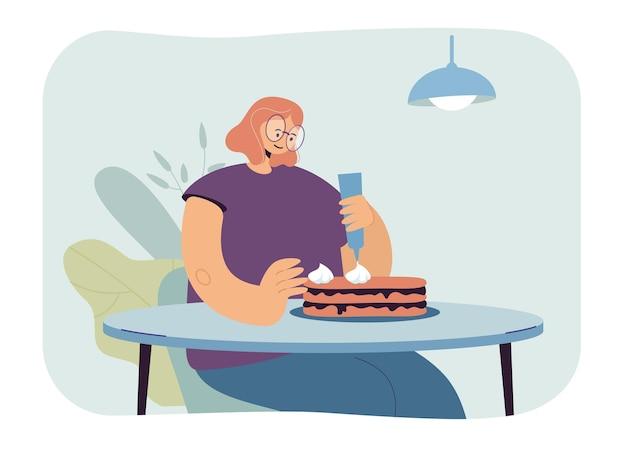 Femme faisant illustration de gâteau