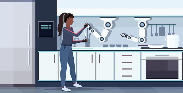 Femme avec fils électrodes indicateurs poignée de main intelligent handy chef robot robotique assistant innovation technologie intelligence artificielle concept moderne cuisine intérieur horizontal