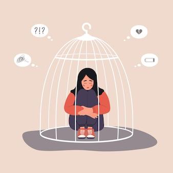 Femme islamique enfermée dans une cage. personnage féminin malheureux en hijab assis sur le sol et serrant les genoux.
