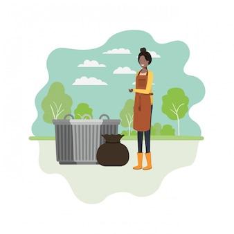 Femme jardinier avec paysage et poubelle
