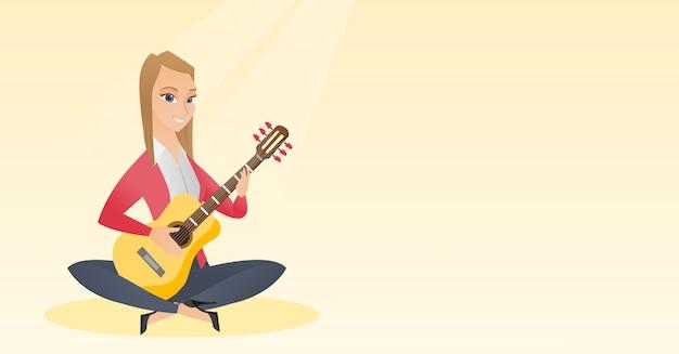 Femme jouant de la guitare acoustique.