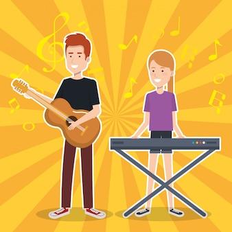 Femme jouant synthétiseur et guitare homme