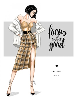Femme en jupe à carreaux tendance