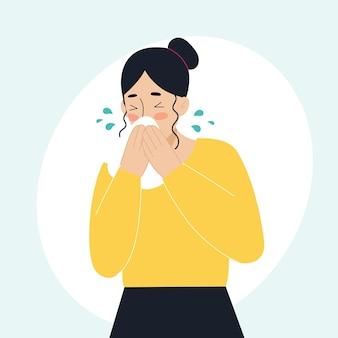 La femme malade a le nez qui coule en éternuant le concept de la fièvre des malades