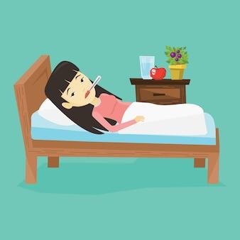 Femme malade avec thermomètre pose dans son lit.