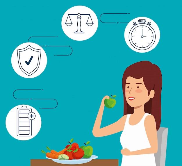 Femme mangeant des fruits et des légumes à style de vie