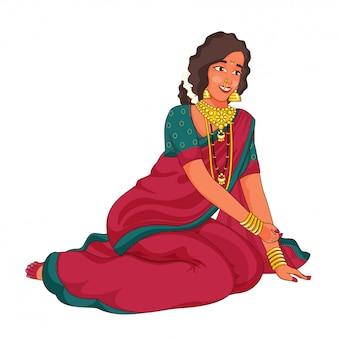 Femme marathi vêtue d'une robe traditionnelle en posture assise.