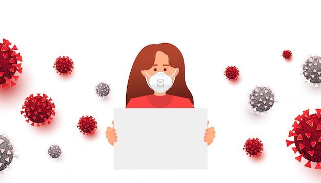 Femme avec masque médical tenant une affiche de protestation et des cellules de coronavirus autour.