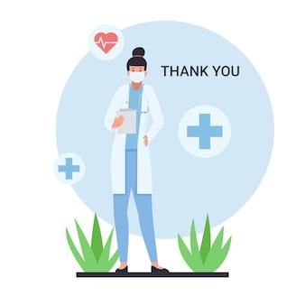 Une femme médecin tient un papier avec un texte de remerciement