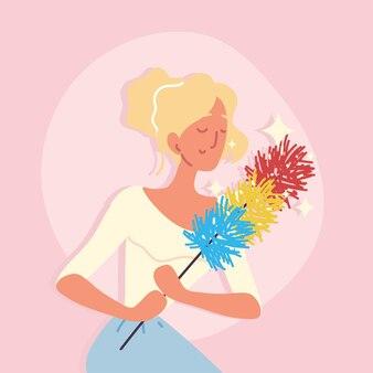Femme de ménage tient un plumeau
