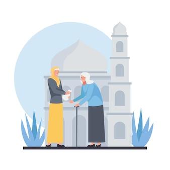 Une femme musulmane donne la zakat à la vieille dame.