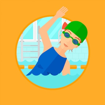 Femme nageant dans la piscine.
