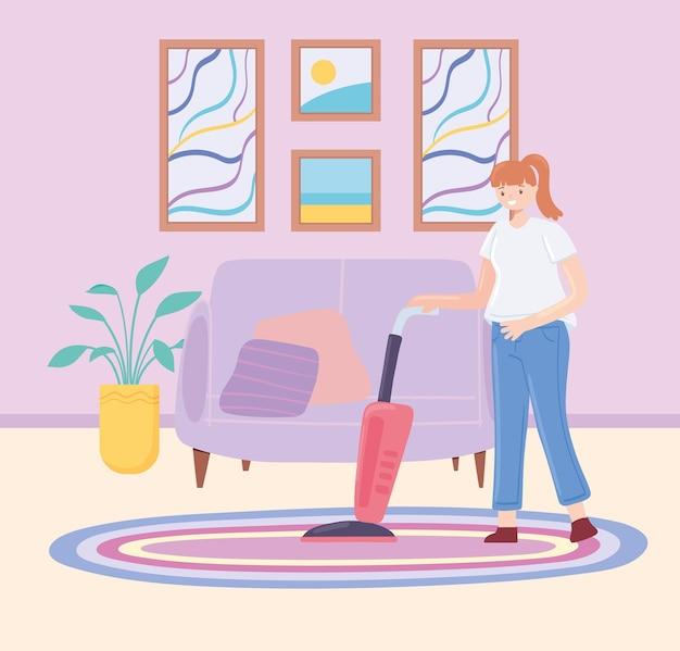 La femme nettoie la maison