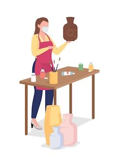 Femme peignant un vase d'argile plat. passe-temps créatif pendant la pandémie.