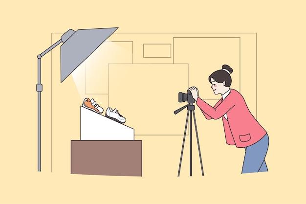 Une femme photographe fait des prises de vue de produits commerciaux