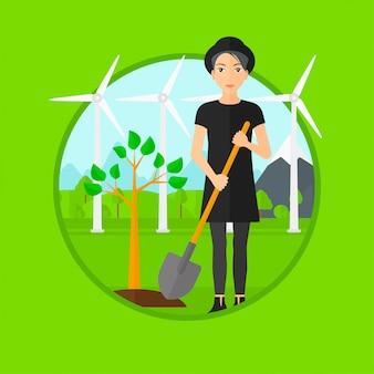 Femme plante des arbres.
