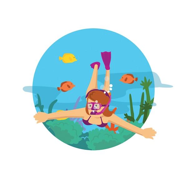 Femme plongeant dans l'océan nageant avec des poissons et des récifs
