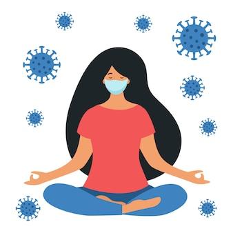 Une femme pratique le yoga avec un masque médical sur son visage. protection contre le coronavirus. quarantaine à domicile.