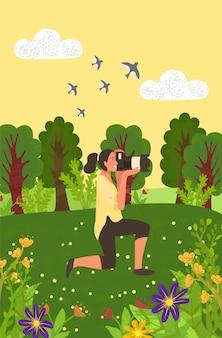 Femme prenant des photos de la nature, photos de prés