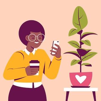 Femme prenant des photos de plante