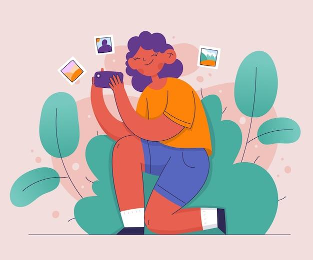 Femme prenant des photos avec un smartphone