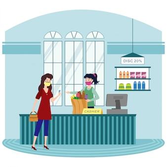 Une femme qui paie ses articles à la caisse de l'épicerie
