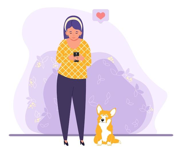 Femme regardant le téléphone à côté de son illustration de chien