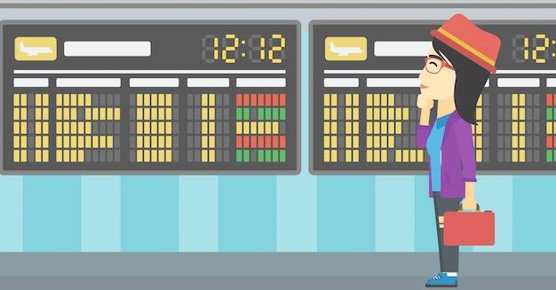 Femme, regarder, tableau horaire, aéroport