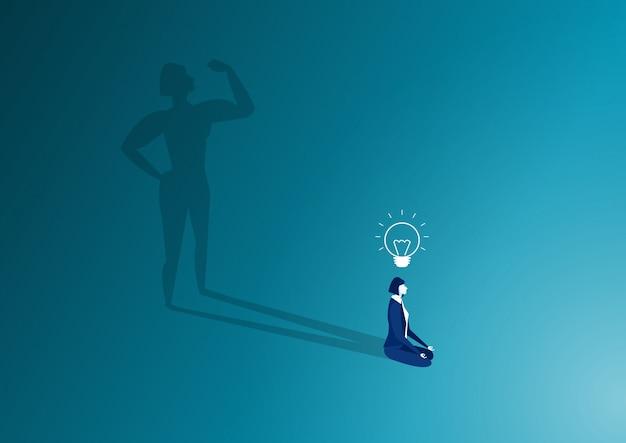 Femme s'asseoir dans la posture de méditation et forte ombre du corps de la femme. concept de détente après le travail. batterie à haut niveau d'énergie